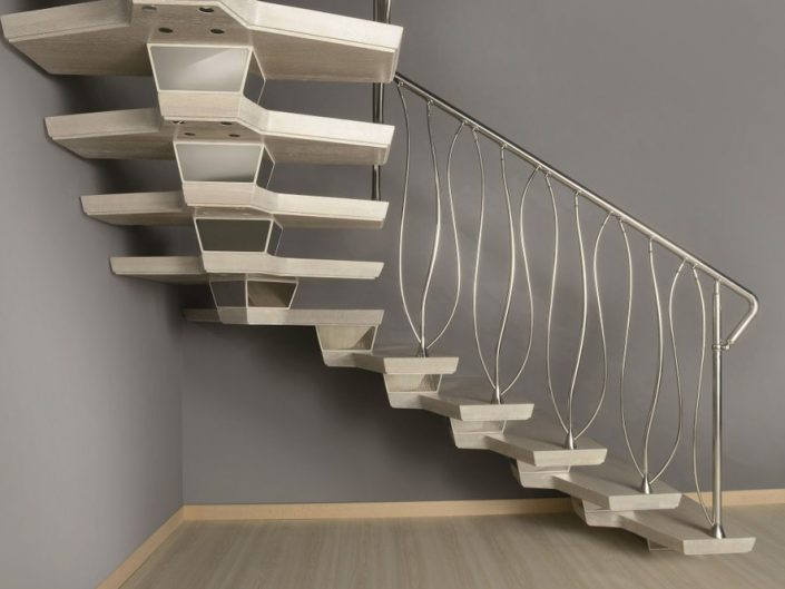 Central spine staircases skeletal style spine with acrylic centre and handcrafted wooded treads resin finished like travertine stone and double curved stainless steel spindles