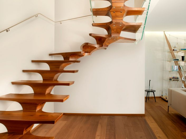 Central spine staircases hand crafted oak treads with frameless glass balustrade