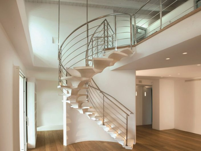 Central spine staircases hand carved spine white with stainless steel traversal rod balustrade